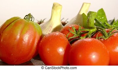 tomatoes, garlic and basil on white background