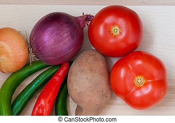 Tomatoes, green and red pepper, onion, potato