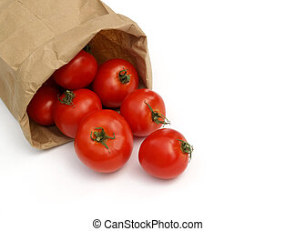 red ripe tomatoes tumbling out of a brown paper bag
