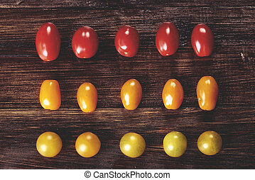 Tomatoes in the row on wooden desks