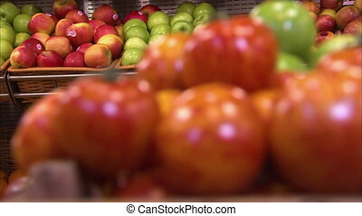 Tomatoes in the supermarket - A blur to focus shot of...