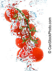 Tomatoes in the water with air bubbles