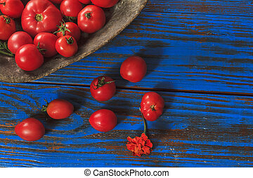 tomatoes in wooden buckets