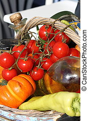 Tomatoes, oil and fresh vegetables
