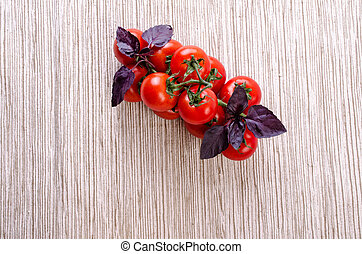Tomatoes on a branch and basil.