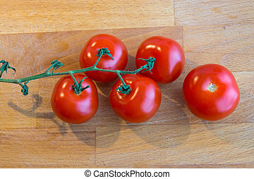 Tomatoes on a chopping board