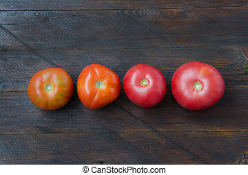 Tomatoes on a wooden background