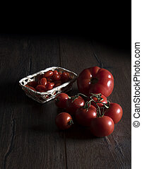 Tomatoes on a wooden table in rustic style