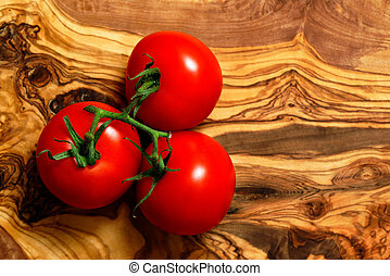 Tomatoes on an olive wood board
