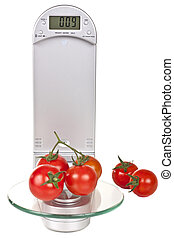 Tomatoes on electronic kitchen scales