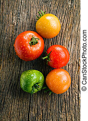 tomatoes on old wooden table