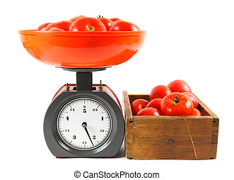 Tomatoes on scales and in a box.