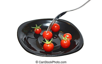 tomatoes on the black plate