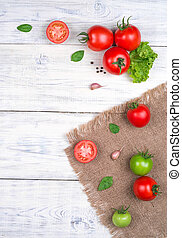 tomatoes on white wooden table, pasta ingredients top view