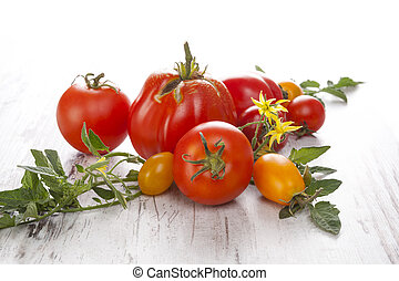 Tomatoes on wooden background