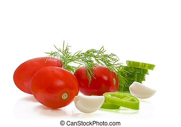 Tomatoes, peppers, garlic, cucumbers on white isolated background