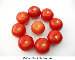 Tomatoes in a circle on white table