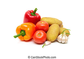 tomatoes, potatoes, peppers and garlic isolated on white background