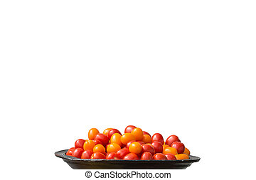 Tomatoes red and yellow on large plate