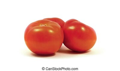 Tomatoes Rotating On White