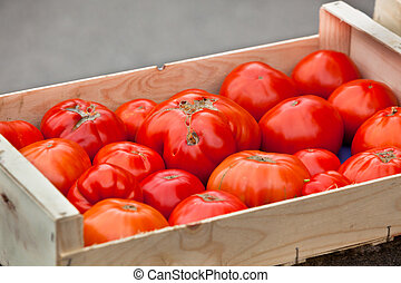 Tomatoes selling in a farmers market