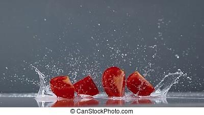 Tomatoes, solanum lycopersicum, Fruits Falling on Water, Slow Motion 4K