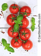 Tomatoes tomato red vegetable portrait format top view basil