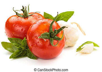 Tomatoes . - Tomatoes, garlic and basil on white background.