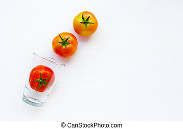 Tomatoes with glass on a white.