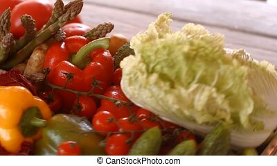 Tomatoes with potatoes and broccoli. Tray with vegetables is...