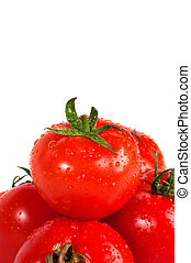 Fresh organic red tomatos arranged over a white background