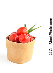 Tomatos in paper bag on white