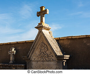 Tomb and cross in the cemetery