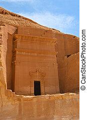 tomb entrance in Madain Saleh -  Saudi Arabia