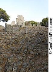 Tomb of the gigants (Tomba dei giganti) at sunset. Sardinia,...