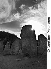 Tomb of the gigants (Tomba dei giganti) at sunset. Sardinia,...