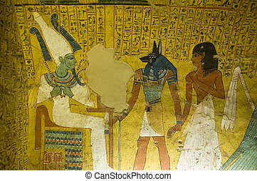 The King of the Underworld - Osiris is presented with the noble Irynefer by Anubis, god of mummification. Wall painting in the Ancient Egyptian tomb of Irynefer at Deir el Medina near Luxor, Egypt. Ancient tomb painting, over 1000 years old.