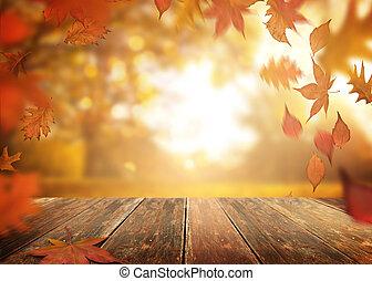 tomber, feuilles automne, sur, a, table bois, fond