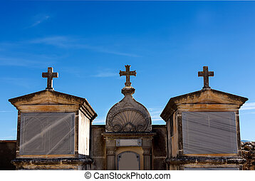 Tombs and cross in the cemetery