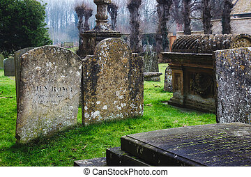 Tombs and headstones in a typical English church graveyard