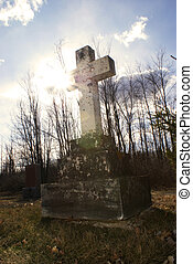 Tombstone - An old tombstone in a quiet gravesite with the...