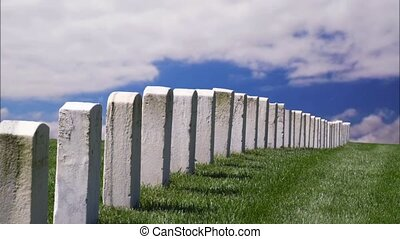 Tombstone Clouds Loop - White military grave stones in a...