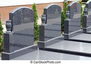 Couple of empty marble tombstone.