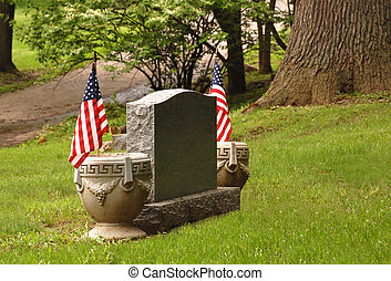 tombstone with flags - Tombstone with an American flag on...