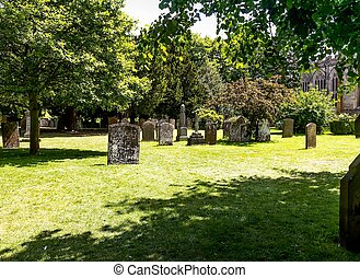 Tombstones in the graveyard - Shakespeare's Church, the Church of the Holy Trinity in Stratford-upon-Avon
