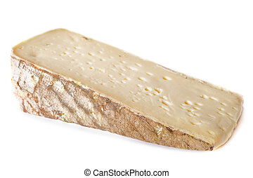tomme cheese in front of white background