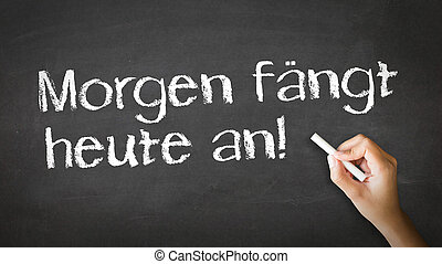 Tomorrow starts today (In german) - A person drawing and...
