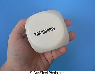 Tomorrow - A hand holding the message Tomorrow.