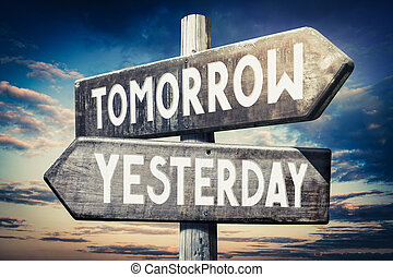 Tomorrow, yesterday - wooden signpost, roadsign with two arrows