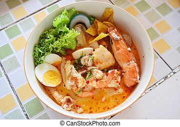 Tomyum noodle with seafood